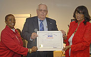 New York Metro Area APWU retiree Eleanor G. Bailey and local President Clarice Torrance with Doug Holbrook.