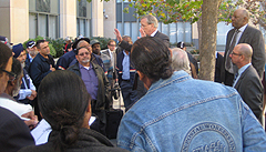 Motor Vehicle Service drivers listen to an update outside the federal courthouse Nov. 9. 2012
