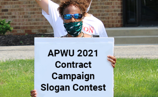APWU member holds a sign at a rally. The sign has been altered to read: APWU 2021 Contract Campaign Slogan Contest