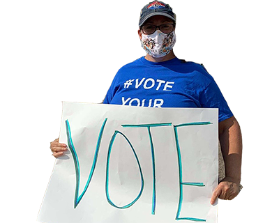 """APWU member holding a """"vote"""" sign"""